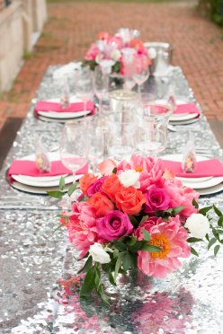 The table was waiting for the bride's bouquet for the center to complete this look. Don't forget to repurpose for your wedding reception.