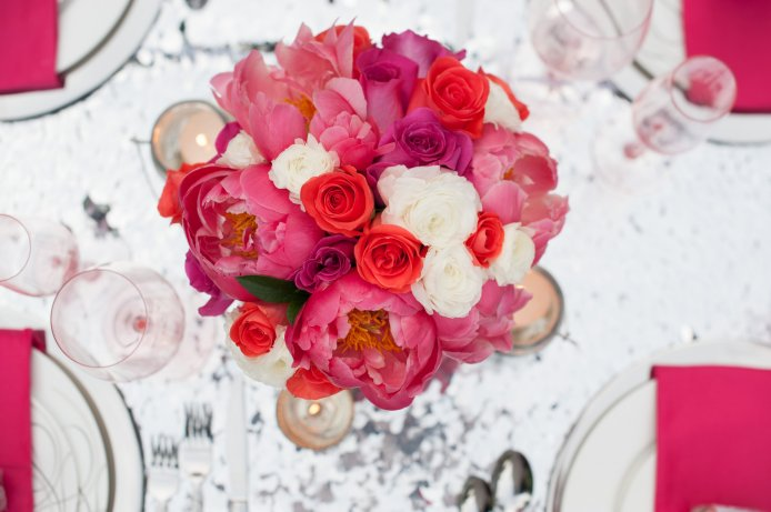 Sparkle and pop would describe this bright centerpiece on this stunning linen.