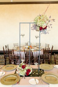 Custom made black iron stands with candlelight, floral of antique hydrangea, celosia, red branches and black bacarra roses.