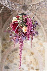 Custom made floral inside an iron sphere hung from the chandelier