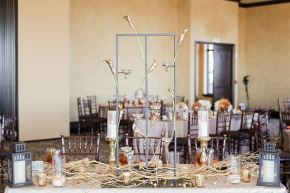Callas and gold votives on a custom black iron stand