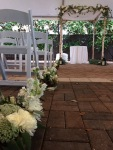 Aisle markers on the ground, repurposed to the reception tables after the ceremony