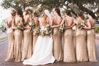 Unique pose of a bride with her maids