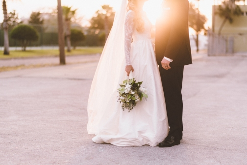 Sunset captured between bride and groom