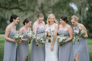 A fun moment with our bride and her maids. Love the natural tones of the Maids' bouquets, filled with greens and white stock paired with their grey gowns.