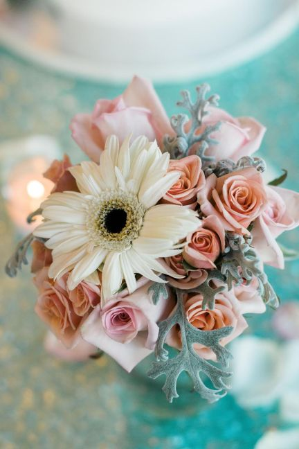 Close up of our pastel colored Maids' bouquet with white Gerber Daisies, peach Spray Roses, blush Standard Roses, and Dusty Miller.