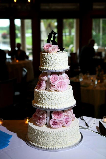 Our cake floral design of stacked layers of pink Garden Roses and Spray Roses.