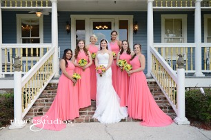 Brides bouquet of coral charm peonies, orange sunset garden roses, green jade hypericum, golden galaxy spray roses, and craspedia. Bridesmaids bouquets of lime green hydrangea, jade green hypericum, and golden galaxy spray roses.