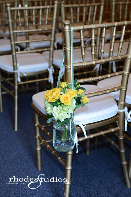 Aisle runners of lime green hydrangea, golden galaxy spray roses, and jade green hypericum in mason jars.