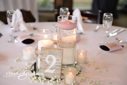 Scattered babies breath around the candle light centerpiece.