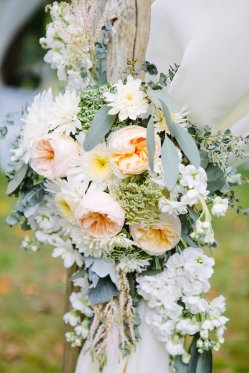 Juliet garden roses, dusty miller, queens ann lace, white stock and eucalyptus adorn this entry for the bride.