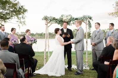 Ceremony begins in front of our birch wood arch with floral and garland.