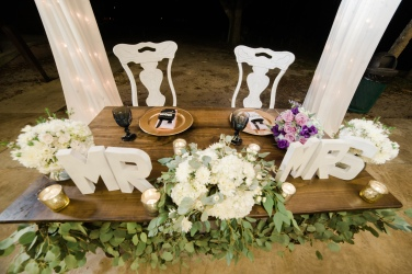 Sweetheart table with the re-purposed garland and floral from the ceremony arch. This is a great way to save money on your floral and decor budget.