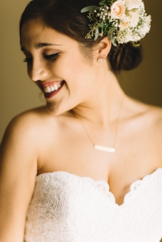 Lovely bride with hair floral accent.
