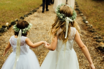 The flower girls wore halos of babies breath, spray roses and trailing ribbons. How adorable are they!!