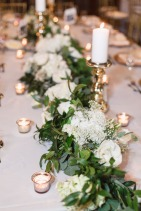 Greenery garland made with ruscus, eucalyptus, white hydrangea, babies breath, white tibet roses, and white majolika spray roses.