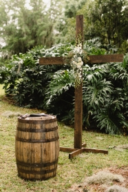Ceremony cross with greens, succulents and floral.