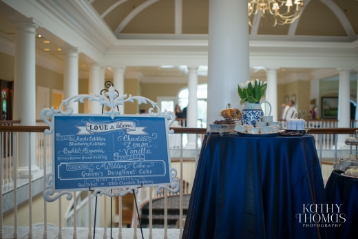 Miniature hydrangea and tulip arrangements set in all blue vases adorn the sweets table.