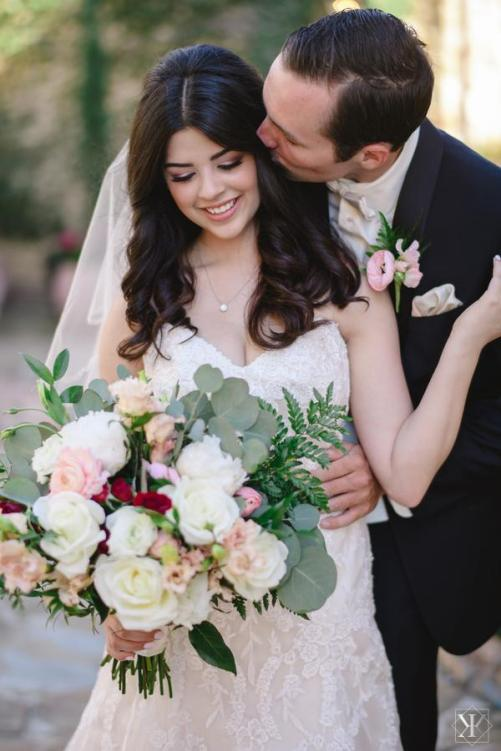 Bridal bouquet of peonies, garden and standard roses, ranunculus, ferns and eucalyptus.