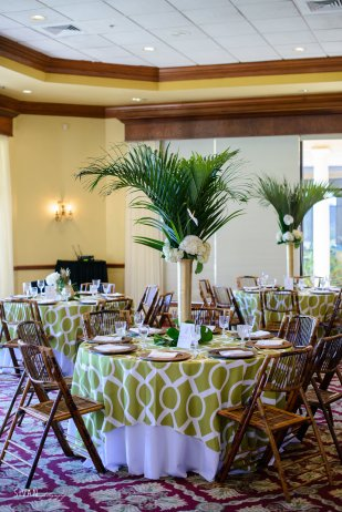 Mixtures of tall gold vases with palms and hydrangea.