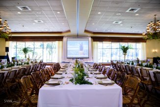 Garlands and bud vases down the family style seating.