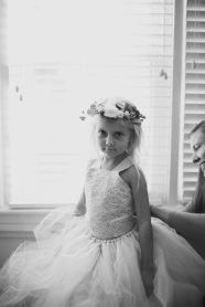 Adorable flower girl with a flower crown