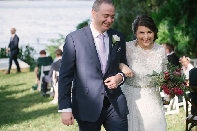 Grooms boutonniere with white listanthus, thistle, and eucalyptus.