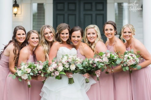 bridesmaids dressed dusty rose with mauve and ivory floral bouquets