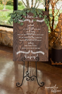 hand painted wooden sign for reception with greenery floral design