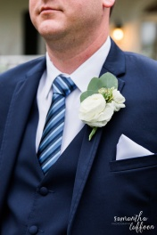 White Ranunculus ans eucalyptus boutonnière, dashing groom in navy tux
