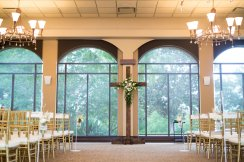 gorgeous cross blush and ivory floral arrangement wedding ceremony