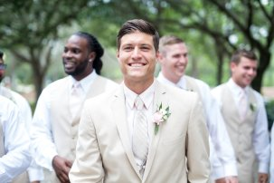 rustic romance groom in kaki tux with blush flower boutonniere